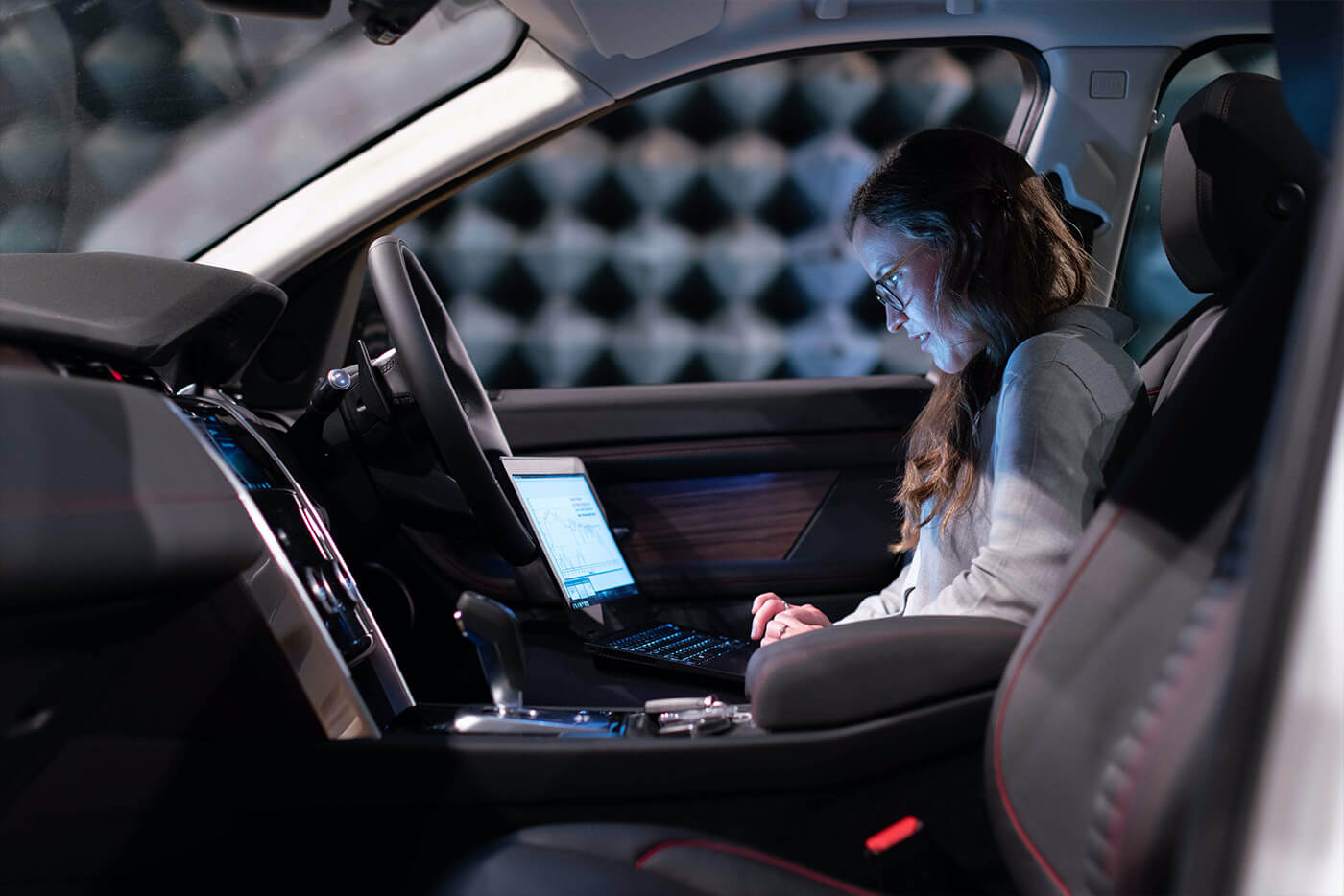 Woman on laptop in car
